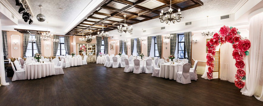 Front view at an interior of a banquet hall ready for wedding