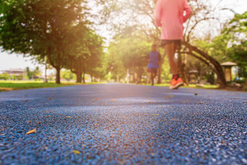 track run rubber cover blue in public park jogging exercise for health and blur people runner. select focus with shallow depth of field