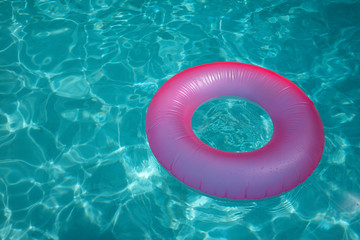 Pink inflate on blue water pool