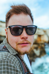 funny portrait of the young man in sunglasses