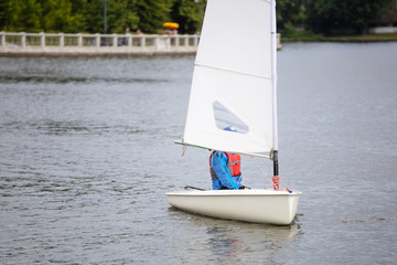 single small sailing boat on the lake