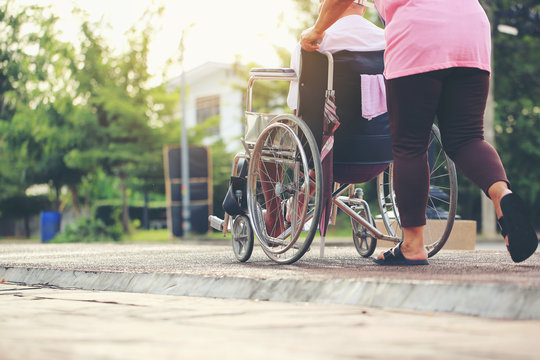 Senior couple with wheelchair in city