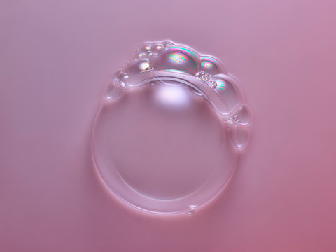 Iridescent bubbles on pink surface