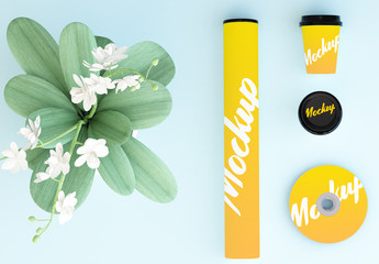 Mockup of CD, Coffee Cups, and Cardboard Tube with Plant