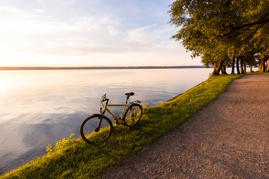 Tutzing at Lake Starnberg, Bavaria, Germany: A bike at the lake during sunrise.