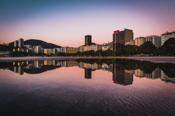 Fotomurales - Panoramic View of Buildings Reflected on Water in Botafogo, Rio de Janeiro, Brazil