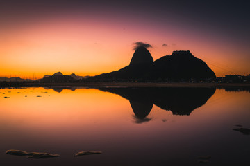 Fototapete - View of the Sugarloaf Mountain Reflected on Water by Sunrise, in Rio de Janeiro, Brazil