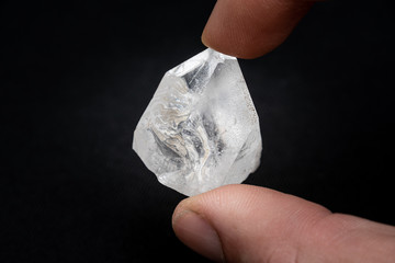 Holding a dob rough diamond formed by volcanic heat and pressure inside the earth Wall mural