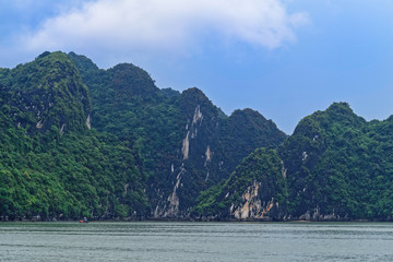 Green mountain islets in Ha Long bay, Vietnam
