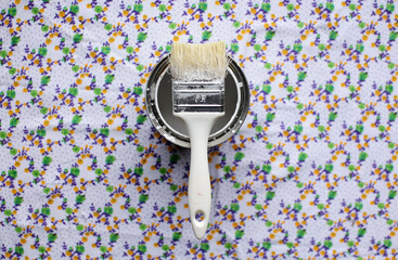 brush and can of white paint