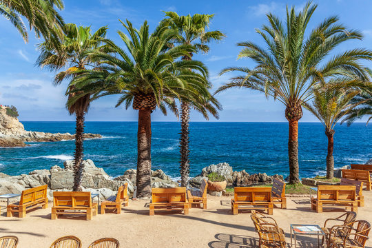 Bar terrace by the mediterranean sea in Lloret de Mar, Costa Brava, Catalonia, Spain.