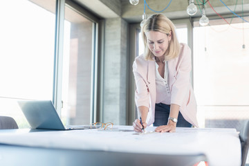 Businesswoman working in conference room in office