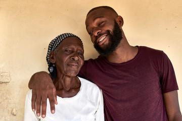 Mozambique, Maputo, portrait of grandmother and grandson