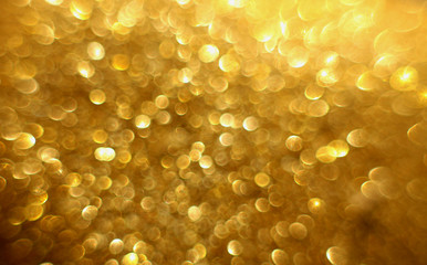 Golden glitter christmas abstract bokeh background. Blurred sparkles backdrop