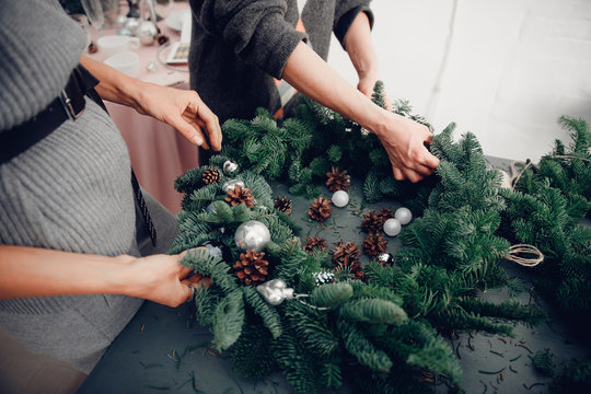 Christmas tree wreath decoration with woman hand workshop DIY