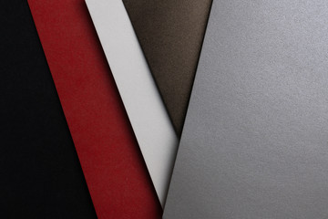 From above layout of pastel glitter cardboard sheets in brown, white, red and grey shiny shades