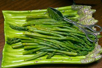 Cooked fresh asparagus on an asparagus serving dish. St Paul Minnesota MN USA
