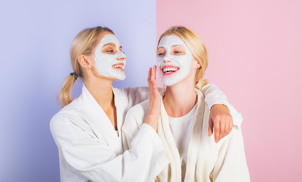 Girls friends, sisters or mom and daughter chilling making clay facial mask. Anti age mask. Stay beautiful. Skin care for all ages. Women pretty smiling girls with clay mask. Pampering routine