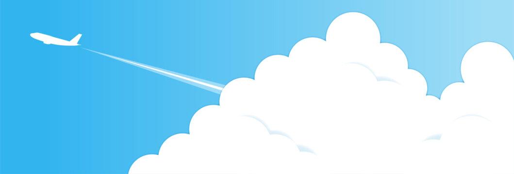 夕焼け空と入道雲と飛行機