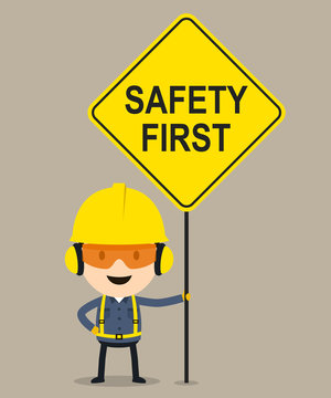 Worker holding safety first sign, Vector illustration, Safety and accident, Industrial safety cartoon