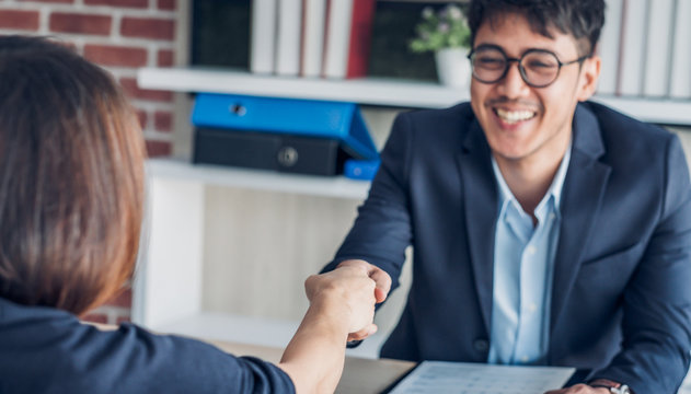 businessman handshake with of interview candidate congraduation for got a  job at meeting room in office