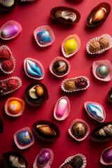Background with chocolate bombons above