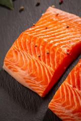 Two slice of fish on slate