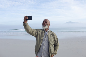 African-American man taking a selfie on the beach