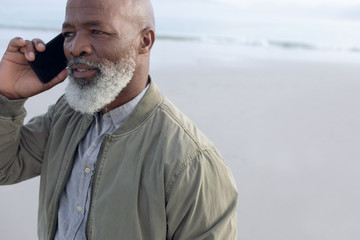 African-American man talking on the phone at the beach