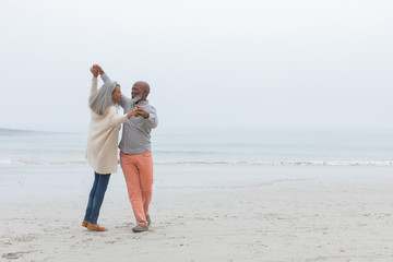 Couple dancing at the beach