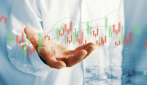 Businessman holding stock chart. business concept