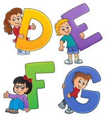 Children with letters DEFG