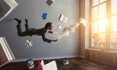 Joyful happe businessman levitating horizontally