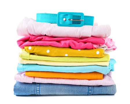 Stack of folded colorful clothes for children and teens.