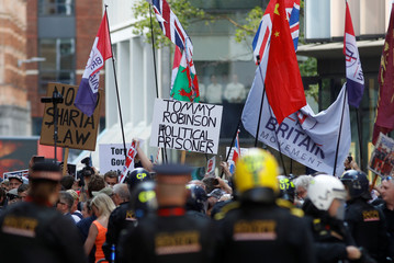 Supporters of far-right activist Stephen Yaxley-Lennon, who goes by the name Tommy Robinson, protest outside the Old Bailey court in London
