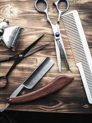 old rusty and new barber shop tools on wood background