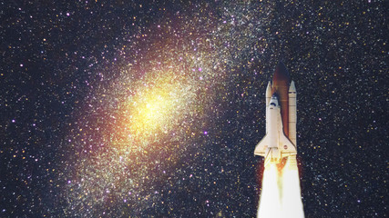 Space shuttle with galaxy. Elements of this image furnished by NASA