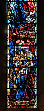 Scenes from the life of Saint Margaret Mary Alacoque, stained glass window in Basilica of the Sacre Coeur, dedicated to the Sacred Heart of Jesus in Paris, France