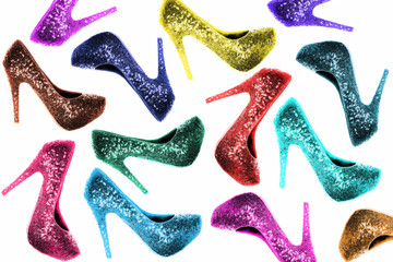 Many colorful high heels over white background