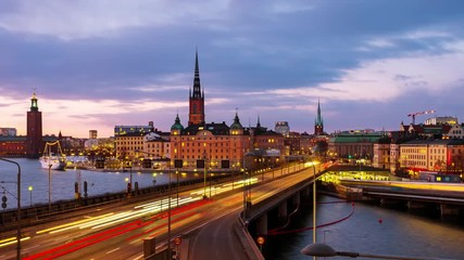 Fototapete - Stockholm, Sweden. Time-lapse of Gamla Stan in Stockholm, Sweden with landmarks like Riddarholm Church during the sunset. View of old buildings and car traffic at the bridge