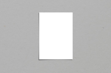 Blank white vertical paper sheet 5x7 inches with shadow overlay. Modern and stylish greeting card or wedding invitation mock up. Wall mural