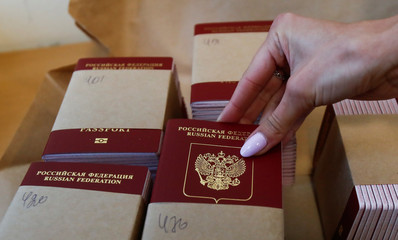 Russian passports are pictured at Goznak printing factory in Moscow