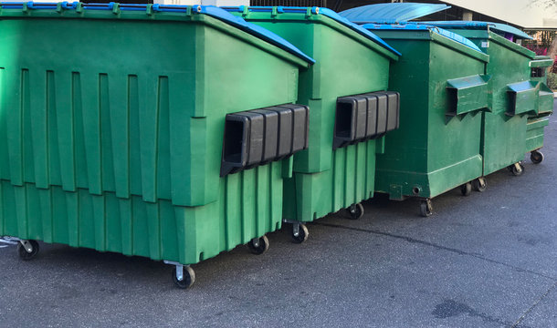 Group of Garbage Dumpsters. Photo image