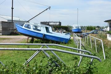 blue motor boats in marina