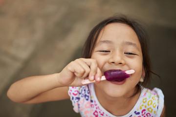 Asian girl eating ice cream in outdoor