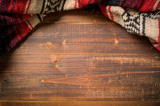 Mexican Serape blanket on wood Background