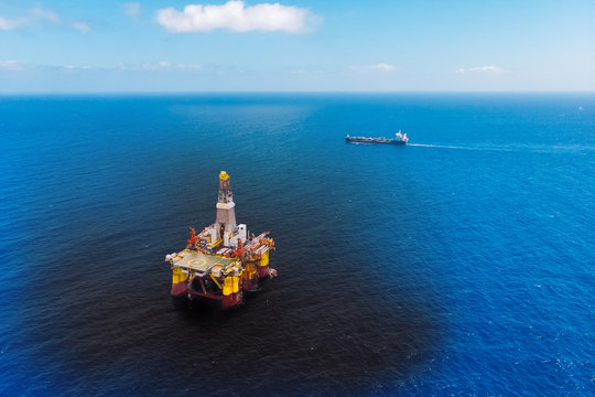 Oil rig accident spill into sea, aerial top view. Concept ecological disasters water