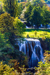 Wall Mural -  Sunny lawn at the waterfall