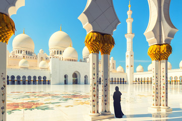 Wall Murals Abu Dhabi Woman wearing abaya dress at Sheikh Zayed Mosque, Abu Dhabi, UAE