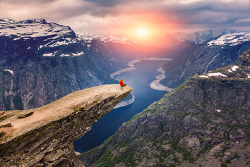 Norway, A woman sits on the mountain's cliff edge of Trolltunga Wall mural